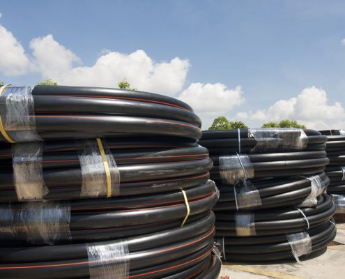 Variety of poly pipe in yard.